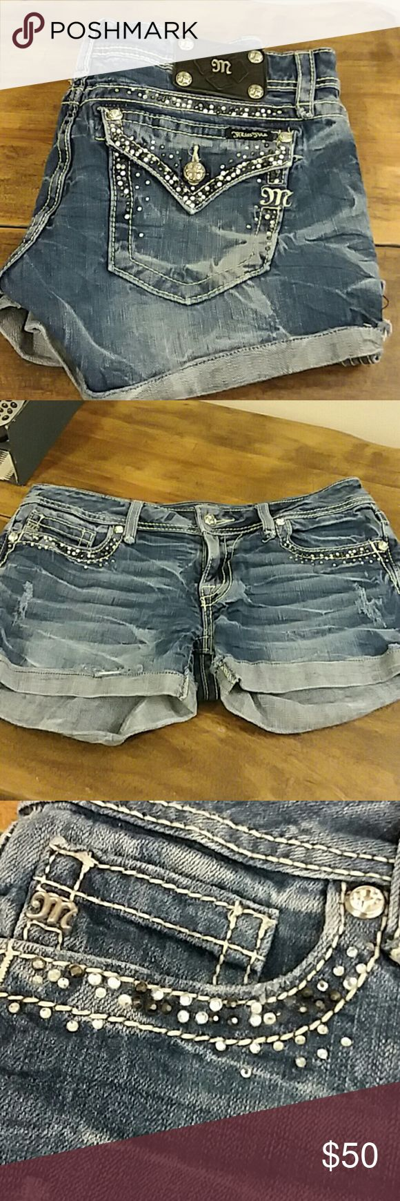 Miss Me Shorts- JE5453H In good condition shorts. Jewels around all pockets. Some fraying and holing designs. Darker wash with light wash accents. Cuff style bottom Miss Me Shorts Jean Shorts