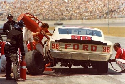 Lee Roy Yarbrough's pit crew changes left side tires and fuels his 1969 NASCAR No. 98 Ford  Torino Talladega. #nascar