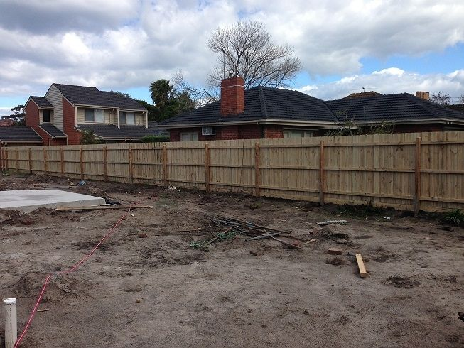 Paling fence with posts and rails. Rear view