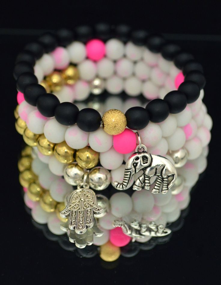 Stackable stretch bracelets from DizzleDesigns.ca - These glass beads have a silicone coating which make the colour pop! Get a custom made one today!