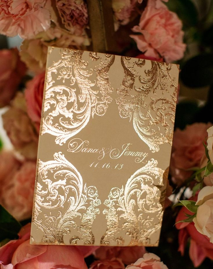 ORNATE ROSE GOLD & VELVET BAROQUE WEDDING INVITATIONS   For Dana's not-to-be-missed Ceci New York invitation design for her  fairy-tale wedding at The Pierre Hotel in New York City, our goal was to  create something that illuminated tasteful luxury. We utilized metallic  rose gold foil printing and soft blush velvet on the back of the invitation  to awaken both the visual and tactile senses. Adorning the invitation with  custom baroque scroll work that was inspired by her wedding gown, each…