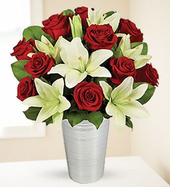 Your big day is coming up? Book a beautiful Red Roses and White Oriental Lilies Bouquet to decorate your wedding venue! For placing an order online, head to our online flower shop without any delay!