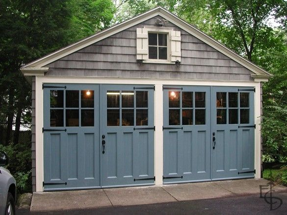 #bldgproductoftheday Carriage doors painted colonial blue; they restore the historic character of this detached carriage house. The blue against the gray shaker shingles is breathtaking, and they really make this home stand out.