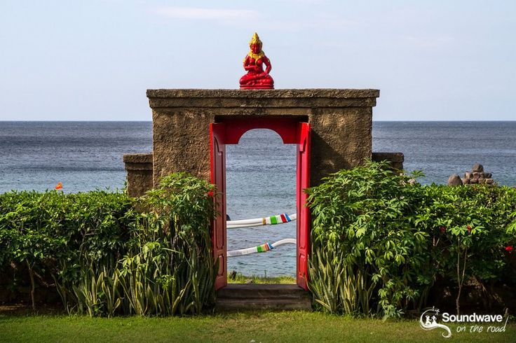 Smiling Buddha stone gate in Amed, Bali