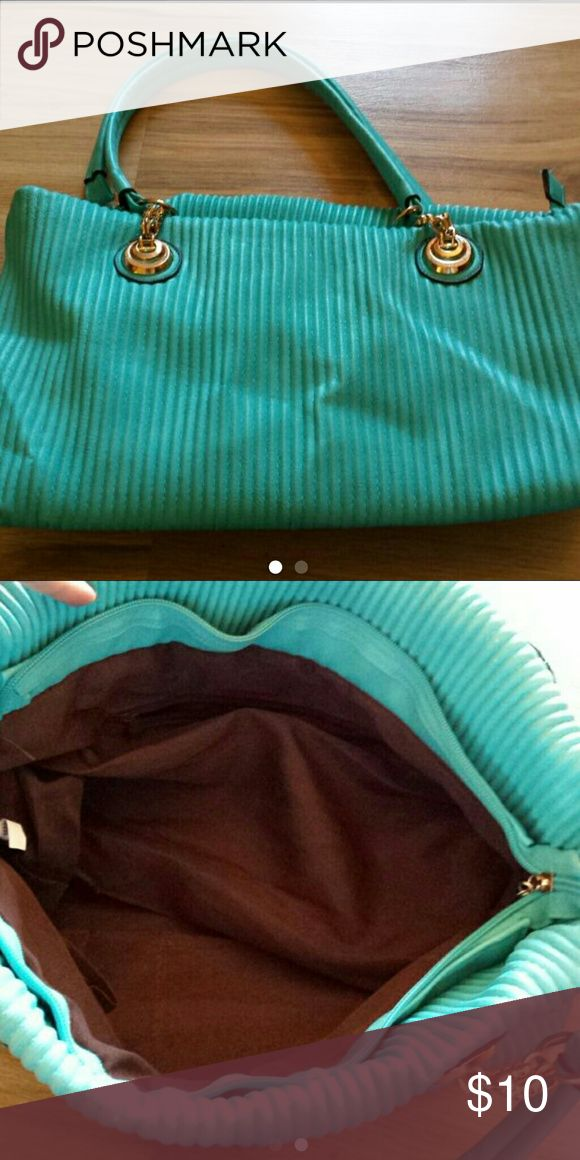 Teal purse No brand.  Normal wear.  Price is firm Bags Shoulder Bags