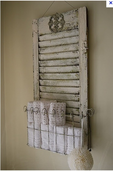15 ways to repurpose shutters - this is my favorite because I just love the way the old fence goes with the chippy shutter ... not seen this one before and it would be perfect for my bath! Easy to do also, and a practical piece.