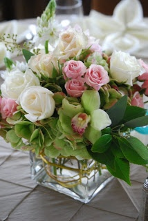 Beautiful arrangment with antique, white and green hydrangea, magnolia leaves, green cymbidium orchids, dahlias, stars of bethlehem, seeded eucalyptus, hypericum berries, roses and spray roses.\\