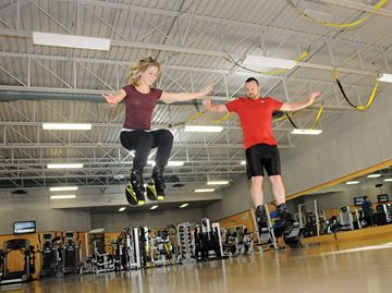 Bouncing like a kangaroo one of latest fitness trends in Barrie - Bounce Fit with Kanga Jumps is one of the new fitness programs available from the City of Barrie. Course instructor Cortnie Gould, left, and Allandale Recreation Centre instructor Patrick Savoury reach new heights in the gym at the centre.