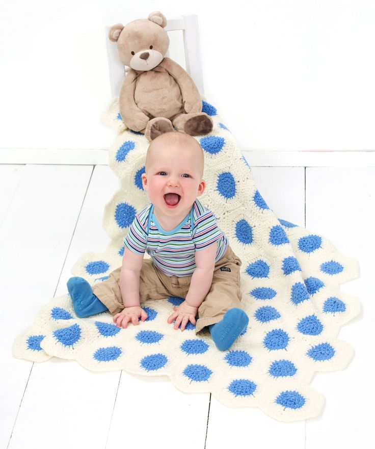 You won't mind seeing dots before your eyes when you wrap that sweet baby in this cool polka dot blanket! If you don't know whether it's a boy or girl, or you want to match the nursery, it's easy to change the center color. You could even use a rainbow of colors for the middles of the hexagons!