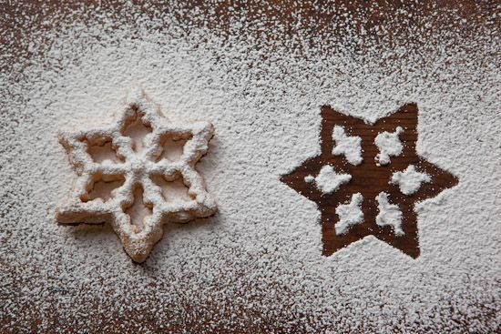 These Scandinavian Rosettes were cooked on the Rosette Iron that belonged to my Norwegian great-grandmother. These delicious fried Scandinavian Christmas cookies are served sprinkled with powdered sugar and are a wonderful treat! | pinchmysalt.com