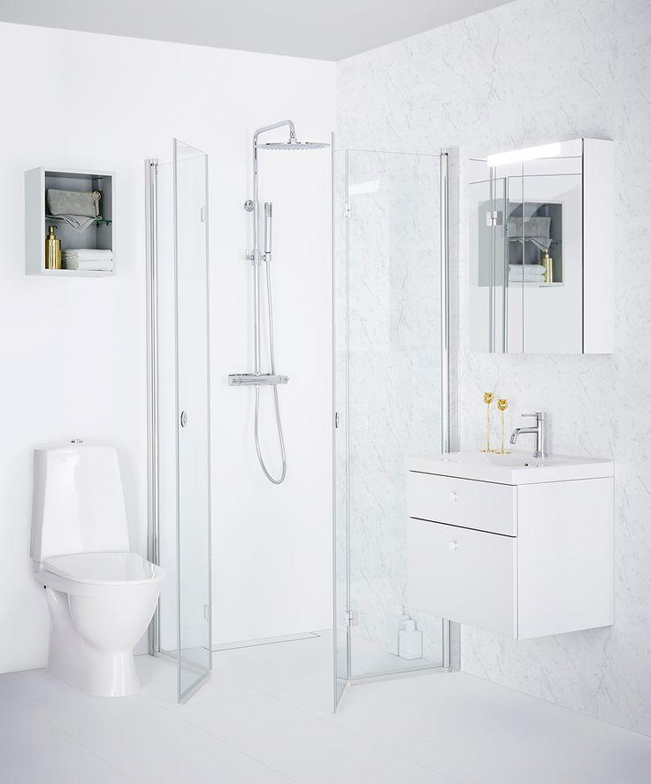 Dusch med vikdörrar för det lilla badrummet
