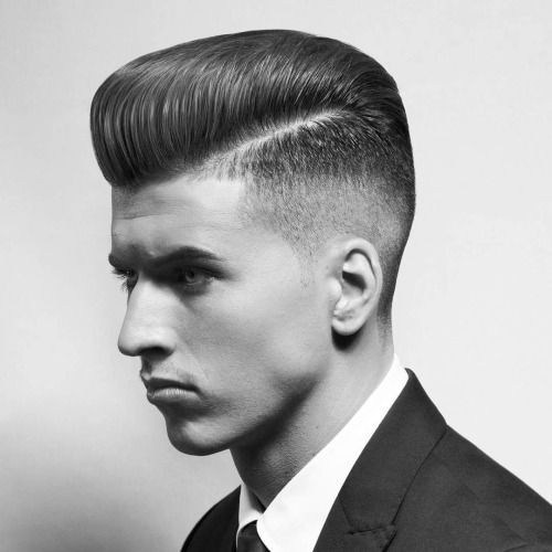 Men in Suit styling himself from pompadour