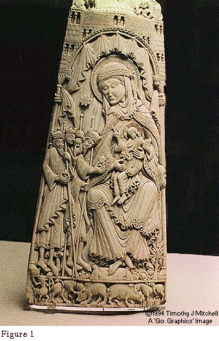 Costume for a 12th Century Lady  By Timothy J. Mitchell  One of the most beautiful of the exhibits in the Medieval Treasury of the London's Victoria and Albert Museum is a carved whalebone panel depicting the Virgin Mary. Entitled 'The Adoration of the Magi' the panel comes from northwest Spain of the first half of the 12th century (see Figure 1). The lady is not shown in costume of the biblical period, but rather as wearing the garb of a 11th-12th century noblewoman.