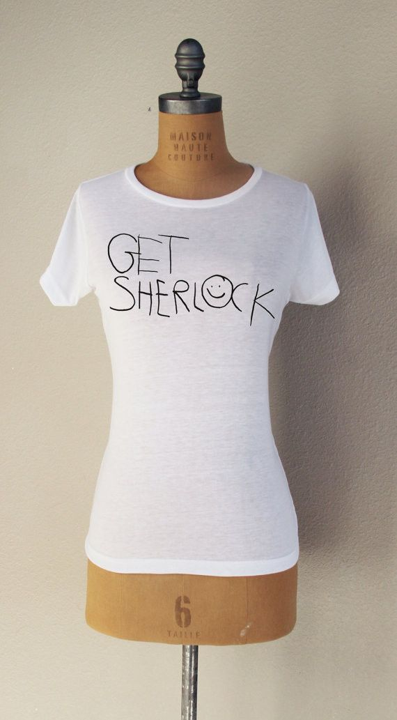 """""""Get Sherlock"""" Short Sleeved T-Shirt Inspired by Sherlock Be absolutely geekiful with this awesome fan-shirt Features: - 100% Polyester - Stretchy and machine washable Size Chart"""