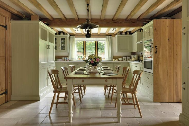 This light country kitchen includes all the ingredients of a timeless kitchen scheme with exposed oak beams adding warmth and character. Visit www.welshoakframe.com for more information. #countrykitchen #traditionalkitchen #oakframe #oakbeams