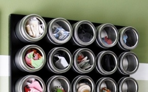 Use a magnetic board and favor tins to organize small things vertically.  This l