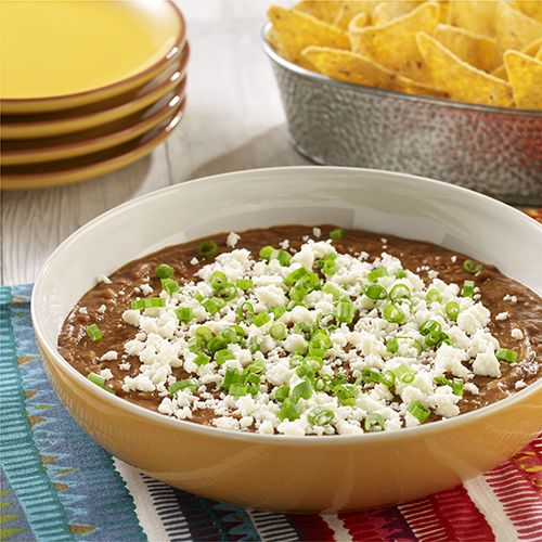 5-Minute Refried Bean Dip: Refried beans and enchilada sauce are heated in the microwave and topped with queso fresco for an easy refried bean dip