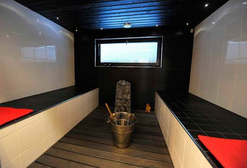 Black and white sauna with red