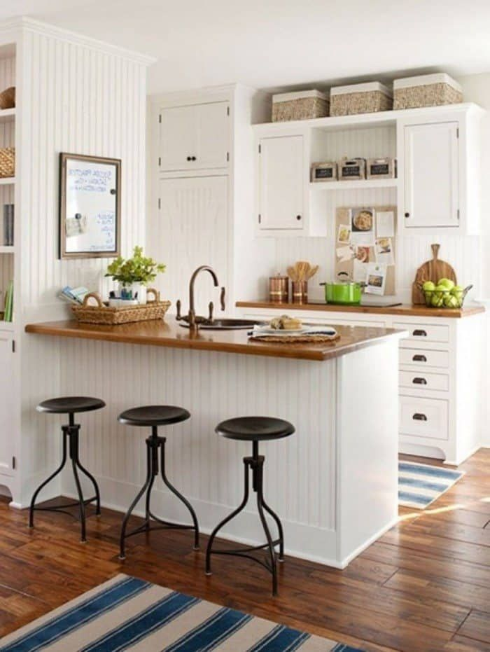 Country Style Kitchen With Baskets Over The Cabinets Decorating Top Of Your
