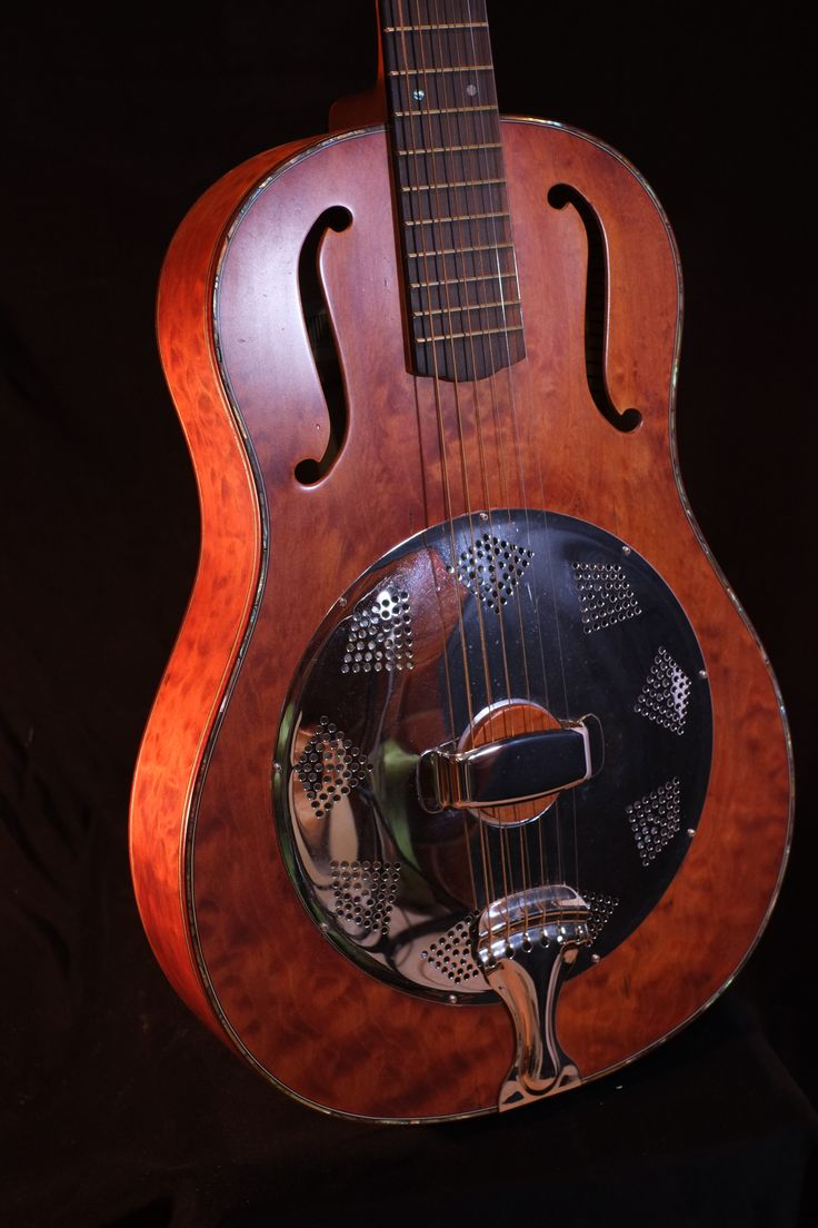 Biscuit bridge resonator in a tobacco stained big leaf maple.