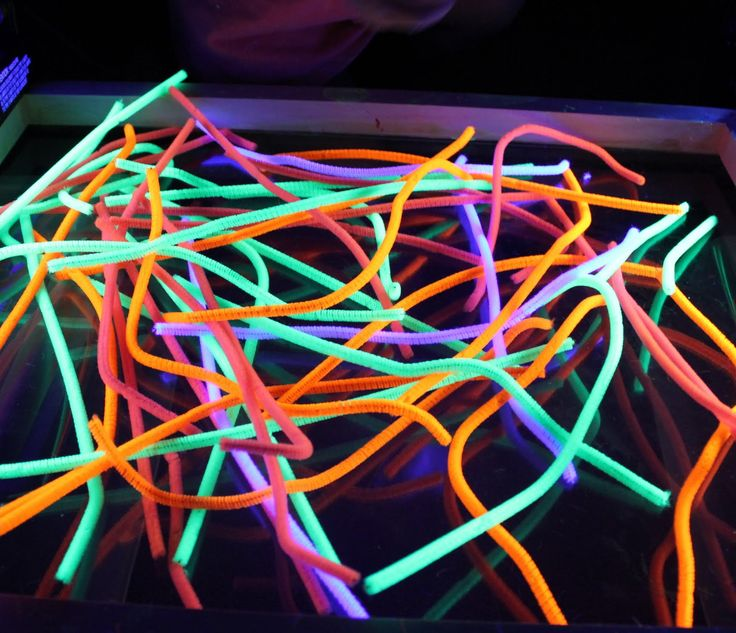Who knew pipe cleaners glow in the dark under a black light?!