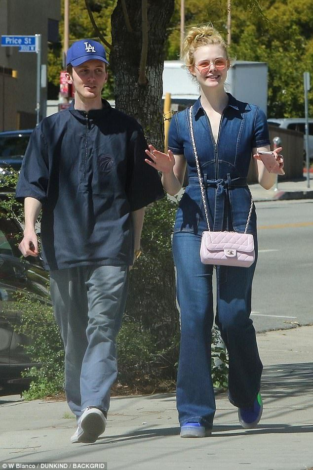b8954b8a1f4b Elle Fanning wears plunging denim jumpsuit as she enjoys ice cream cone  with mystery man