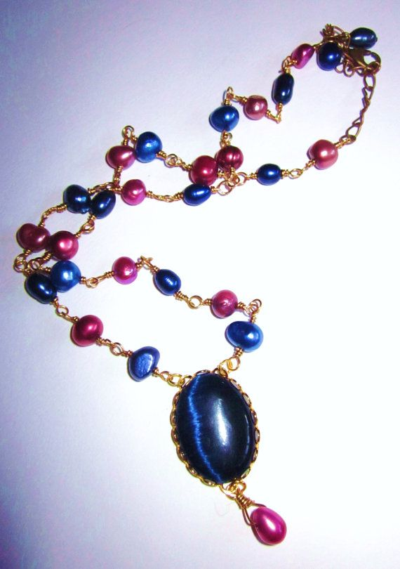 Dark Blue / Navy and Purple Necklace  Cats Eye by LaJolieLolita, $27.50  Dark Blue / Navy and Purple Necklace - Cats Eye Cabochon, Gold Lace Scalloped Setting, Freshwater Pearls - Pearl is a June Birthstone