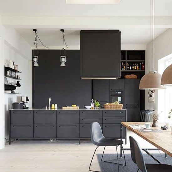 Kitchen-diner with grey handleless cabinetry, wooden table and neutral stone-effect pendant lamps