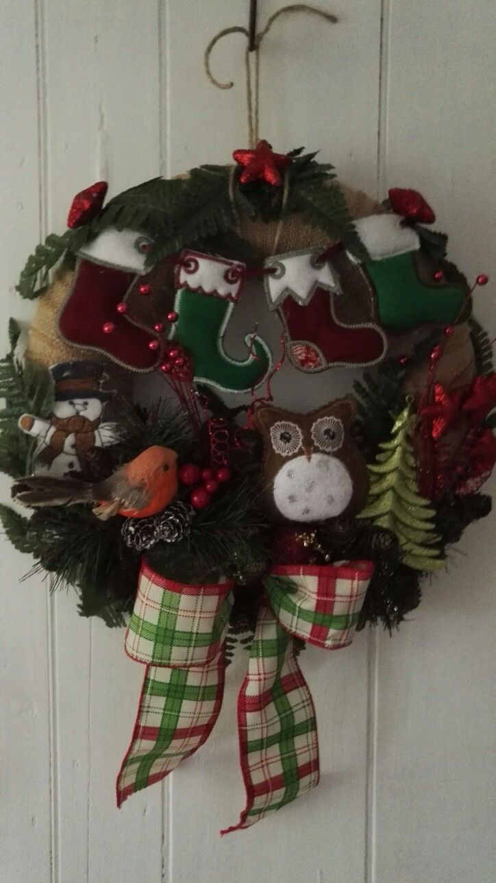 Elves are hanging there stockings up on another Christmas wreath made by me