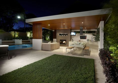 Outdoor entertaining area with Eco Outdoor Scala travertine paving and lap pool. Rolling Stone Landscapes | Eco Outdoor | Scala travertine paving | livelifeoutdoors | Outdoor design | Natural stone flooring | Garden design | Outdoor paving | Outdoor design inspiration | Outdoor style | Outdoor ideas | Garden ideas | Floor tiles | Outdoor tiles | Outdoor entertaining | Luxury homes