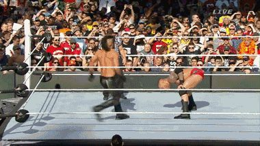 Randy Orton hits an incredible RKO on Seth Rollins at WrestleMania 31! He stole the show and created a huge WrestleMania moment. #WWE #GIF