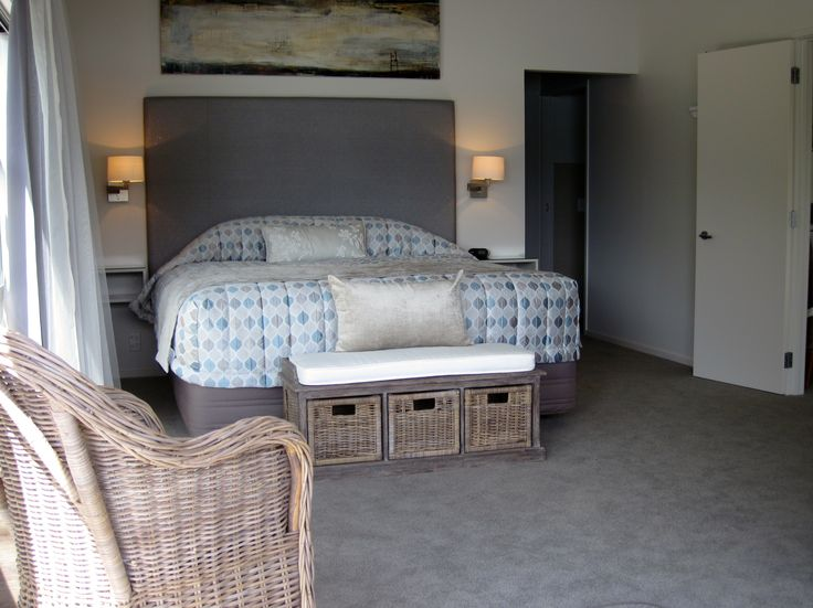 Relax in style and in comfort on the plush king bed in the CO's Suite at Kingfish Lodge
