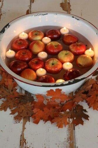 Candles and apples display for a fall party.