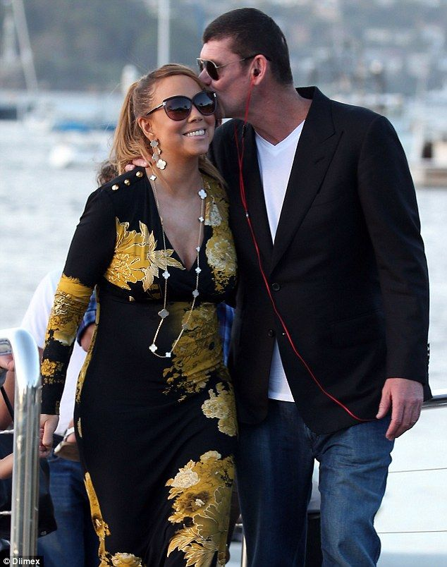 A kiss for my sweet: Mariah Carey and James Packer were loved-up after jetting into Sydney...