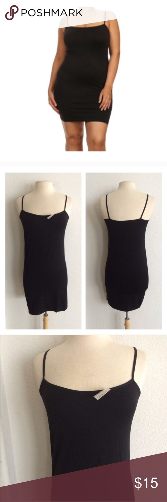 """(L-2x) Black cami slip Plus size camisole slip. 92% nylon/ 8% spandex. Great for wearing under tunics/ dresses that are slightly sheer!  Measures 32"""" long with a 30"""" bust Bust stretches comfortably to about 46"""". These stretch well beyond measurements. I would recommend this for L-2x.  *Please note: this is not a dress. It's meant to be worn under something.  Availability: 3 ⭐️This item is brand new with tags 💲Price is firm unless bundled ✅Bundle offers Tops Camisoles"""