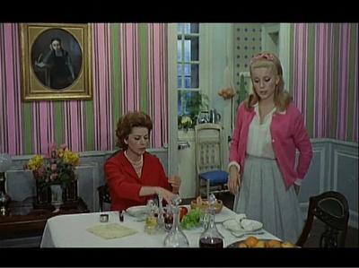 Catherine Deneuve's pink cardigan & coordinating wallpaper in Umbrellas of Cherbourg.