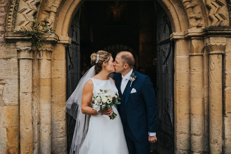 Just married!! Photo by Benjamin Stuart Photography #weddingphotography #weddingday #kiss #brideandgroom #churchwedding #burfordchurch #burford
