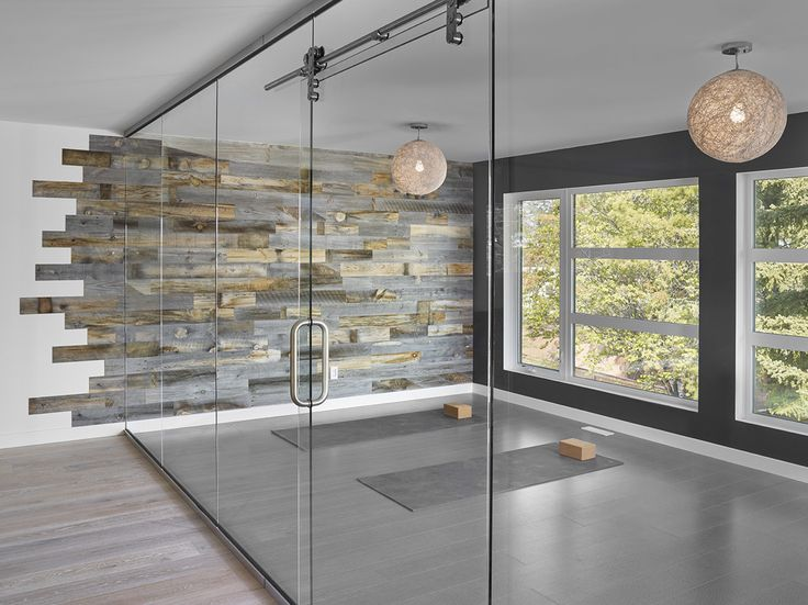 This minimalist yoga studio wanted to bring the soothing comfort of the outdoors into the space and keep with a very modern, minimal design approach. Stikwood Reclaimed Weathered Wood gave them the look and the versatility they needed.  Vote For Your Favorite Stikwood Look. http://voteforyourfavoritestikwood.hscampaigns.com/