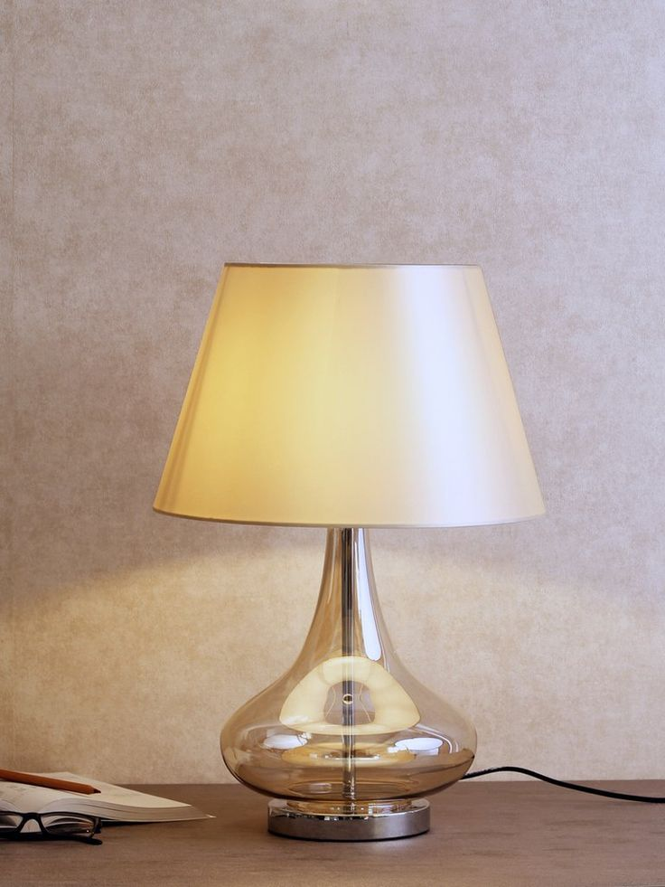 Sanders sleek and contemporary table lamp style in glass construction the sanders features an
