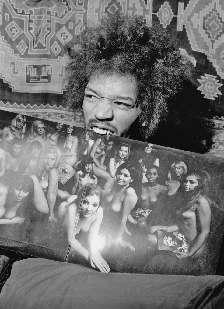 Jimi Hendrix with Electric Ladyland LP. S)with the electric lady land cover that was banned for being pornographic