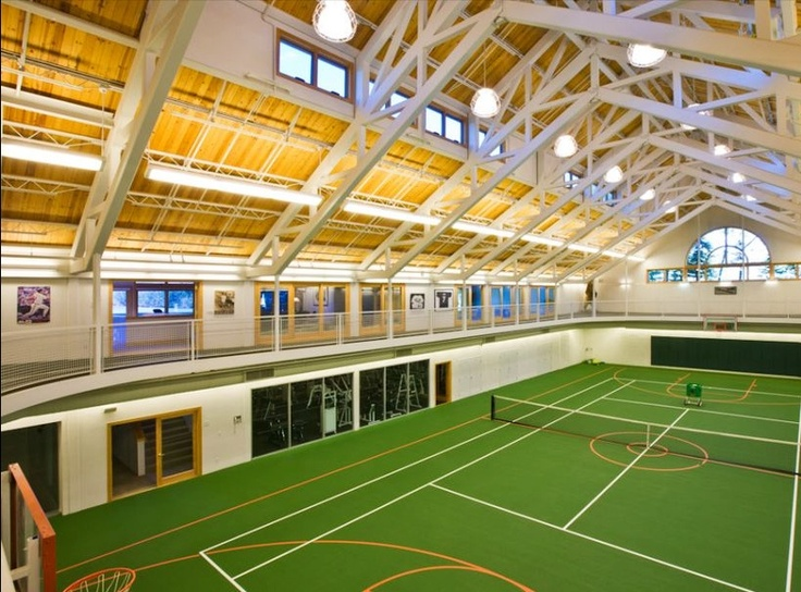 Basketball court with a full running track suspended above