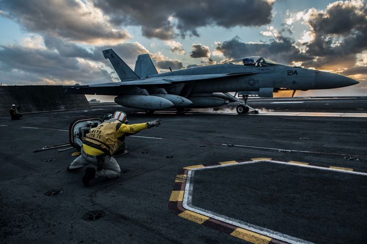 An F/A-18E Super Hornet of Strike Fighter Squadron 27 launches from the flight deck of the Navy's forward-deployed aircraft carrier, USS Ronald Reagan. The Ronald Reagan, Theodore Roosevelt and Nimitz strike groups are underway and conducting flight operations in international waters as part of a three-carrier strike force exercise.