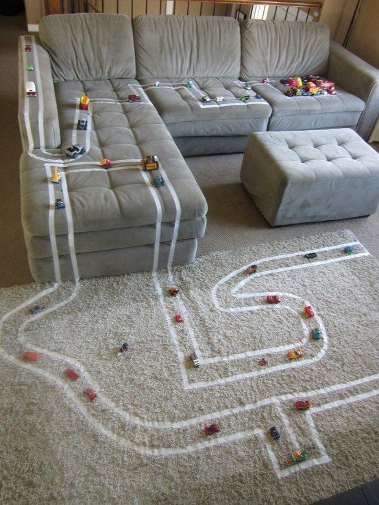 Living Room Roadway 14 Jan  Use thin masking tape to make this toy car roadway. It'll keep your little ones busy for hours!