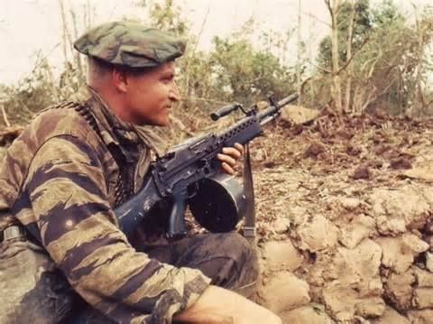 U.S. Navy SEAL armed with Stoner 63 LMG during Vietnam.