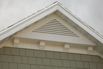 home exterior triangle mission-style gable attic vent with shingle siding. love…