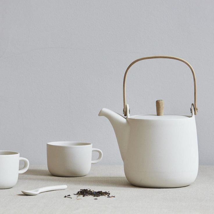 Perfectly simple teapot of ceramic and wood. Individually made from vitrified earthenware, the clay is fired to a high temperature until it is no longer porous, giving it a stone like quality. As each piece is individually made there will be slight variations in each piece, indicative of the material and hand made processes. Sue PrykeMade in EnglandMaterial: Vitrified Earthenware, oak knob, steam bent oak handleSize 190mm H x 160mm LTeapot holds 1 litre / 2 pints or 4 generous mugs, so…