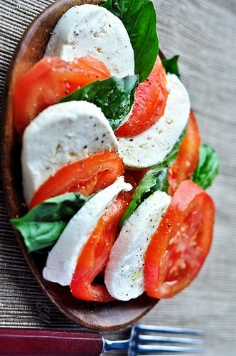 La Caprese - a simple salad made of tomatoes, basil, and mozzarella cheese drizzled with a little olive oil and sprinkled with a little salt.  Try it with some spinach leaves added--yum!