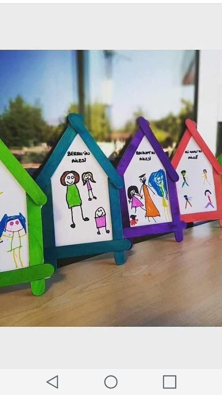 Cute popsicle stick houses with a  picture of their family.