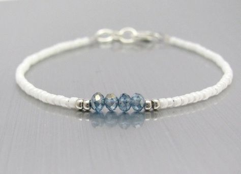 White Friendship Bracelet, Blue Crystal Beads, Seed Bead Bracelet, White Bracelet, Bridesmaid Gift, Minimal Bracelet, Hawaiian Jewelry Dainty Seed Bead Friendship Bracelet Petite White and Blue beaded bracelet Tiny white seed beads mixed with sparkling blue gray crystal beads. 3.5mm crystals at the center, with silver plated glass bead accents. Nickel Free Plated lobster clasp and rings. Wonderful to wear alone, or stacked and layered with your other favorite pieces. Listing is for Purpl...