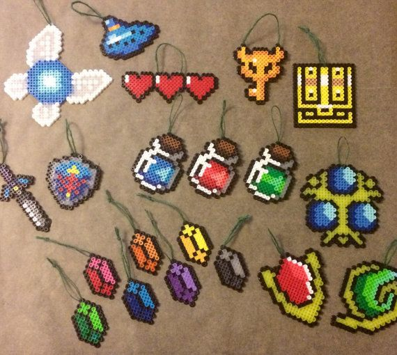 This is a set of Legend of Zelda: Ocarina of Time inspired Christmas Tree ornaments handmade from perfectly fused Perler beads. These are inspired